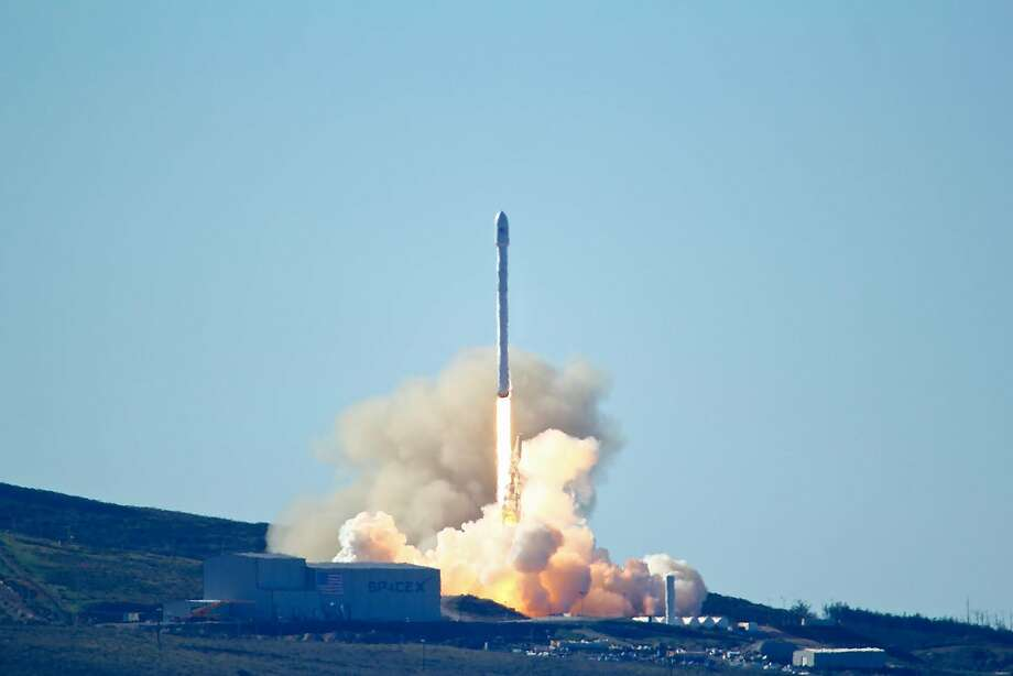SpaceX's Falcon 9 rocket with 10 satellites launches at Vandenberg Air Force Base in January. California regulators are trying to decide how to tax commercial spaceflight companies like SpaceX. Photo: Matt Hartman, AP