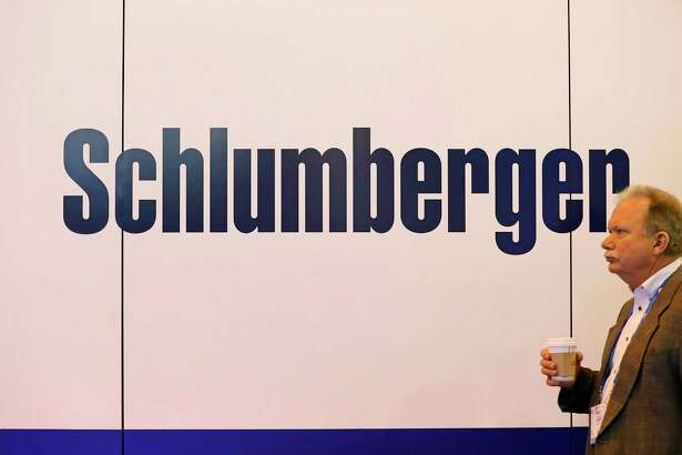 An attendee walks past Schlumberger Ltd. signage during the 2017 Offshore Technology Conference (OTC) in Houston, Texas, U.S., on Wednesday, May 3, 2017. The OTC gathers energy professionals to exchange ideas and opinions to advance scientific and technical knowledge for offshore resources. Photographer: Aaron M. Sprecher/Bloomberg