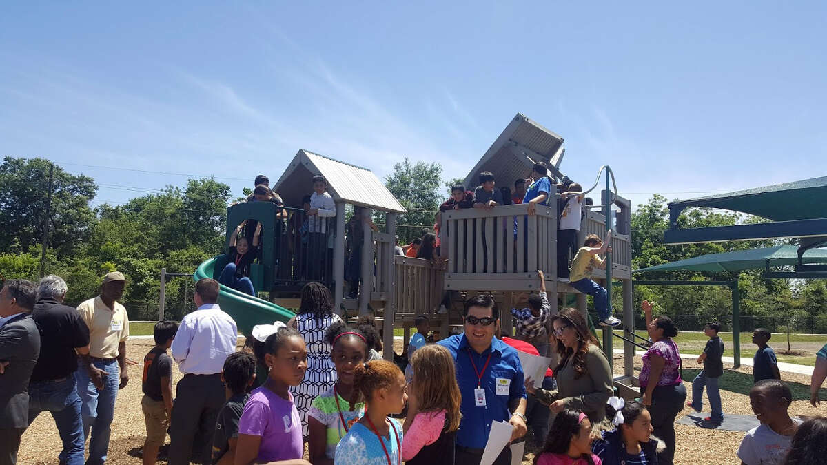 Drew Elementary School students play in the new SPARK Park after the dedication ceremony Thursday, April 27.