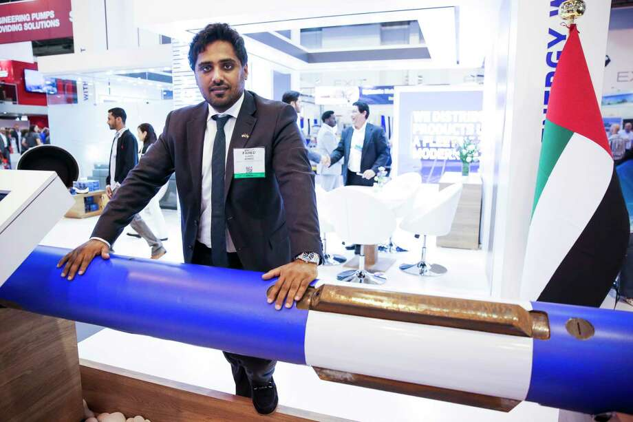 ADNOC employee Fahed Alameri stands next to the drill stabilizer he invented at the oil company's booth at the Offshore Technology Conference at NRG Center Tuesday, May 2, 2017 in Houston. Alameri had to check his laptop on his 17 hour flight to the United States from Abu Dhabi. ( Michael Ciaglo / Houston Chronicle) Photo: Michael Ciaglo, Staff / Michael Ciaglo