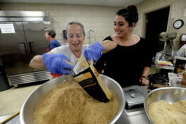 Athina Vasilakis and her daughter Georgia joke with one another as they blend the baklava filling while they and other members of St. Michael's Antiochian Orthodox Church prepare to make trays of Greek baklava in preparation for Saturday's Mediterranean Festival. This year marks the 9th for the annual event, which continues to draw large crowds seeking out the sights, smells, tastes and experiences of Mediterranean culture and cuisine. In addition to food, traditional dance and music is offered, tours of the church are available throughout the day, and there are children's activities. The festival opens at 11 a.m. and runs through 8 p.m. Photo taken Wednesday, May 3, 2017 Kim Brent/The Enterprise