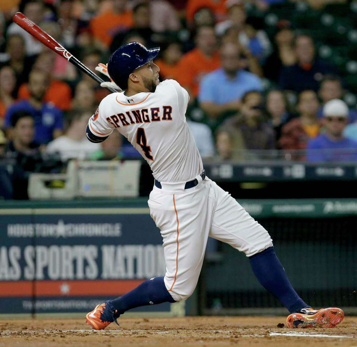 Houston Astros George Springer hits a RBI single against the Texas Rangers during the second inning at Minute Maid Park Wednesday, May 3, 2017, in Houston. Alex Bregman scored on the hit.