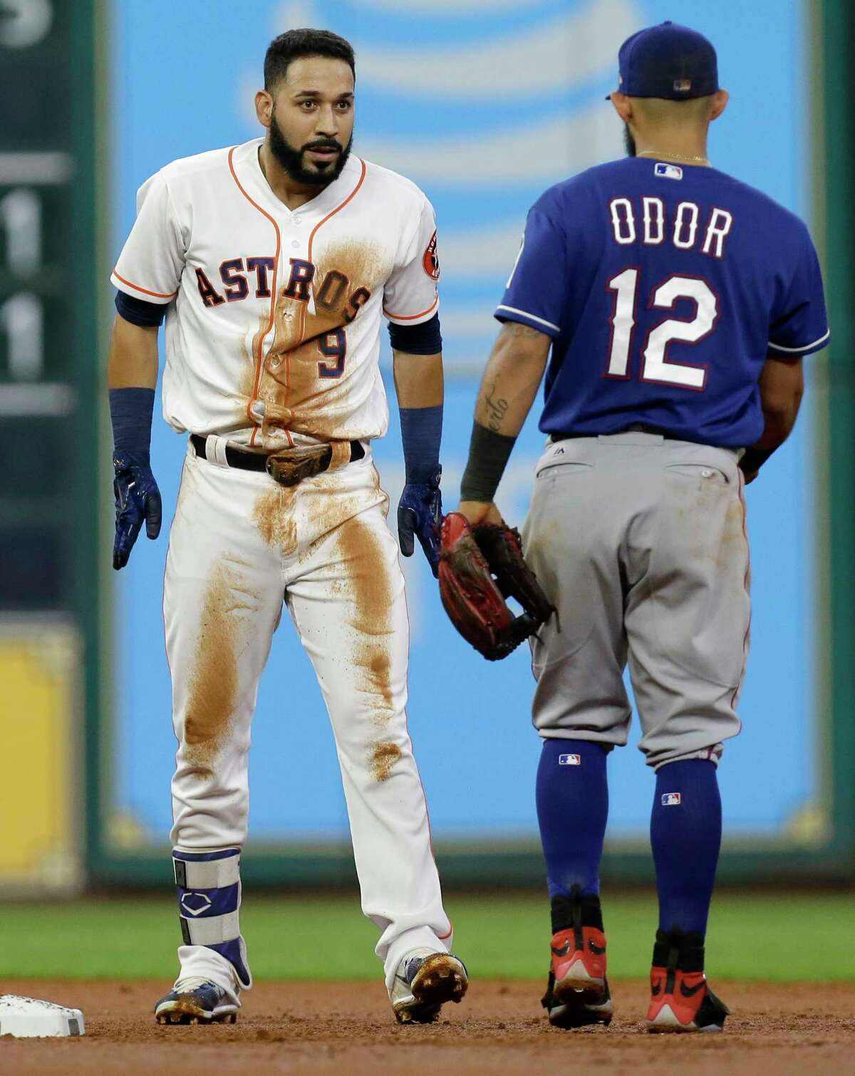 Houston Astros Marwin Gonzalez talks to Texas Rangers Rougned Odor as he dusts himself off after hitting a double during the second inning at Minute Maid Park Wednesday, May 3, 2017, in Houston.