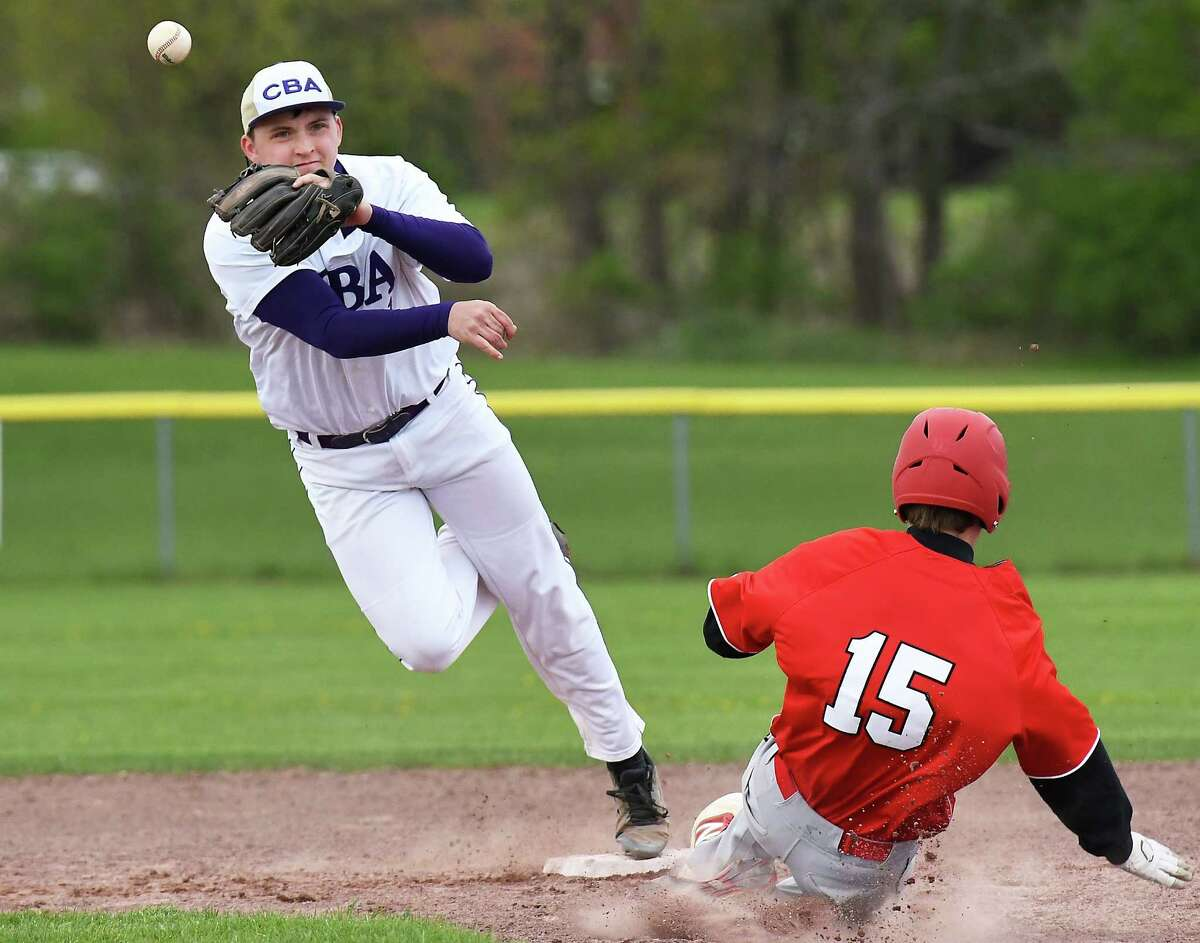 CBA's #1 Peter Close, left, gets Niskayuna's #15 Jake Phillips out at second base and tries for a double play during Wednesday's game May 3, 2017 in Colonie, NY. (John Carl D'Annibale / Times Union)