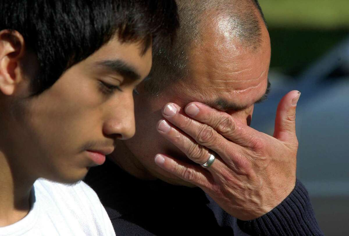 Luis Barrios wipes away tears as he stands next to his 16-year-old son Lester during a press conference held by Luis' immigration attorney Erin O'Neil-Baker, at his home on Chestnut Drive in Derby, Conn., on Wednesday, May 3, 2017. Barrios, a native from Guatemala, has lived in the US for 25 years, and was was just two days away from being deported. Barrios has been granted a 30-day stay with help from U.S. Sen. Chris Murphy, U.S. Sen. Richard Blumenthal and U.S. Rep. Rosa DeLauro.