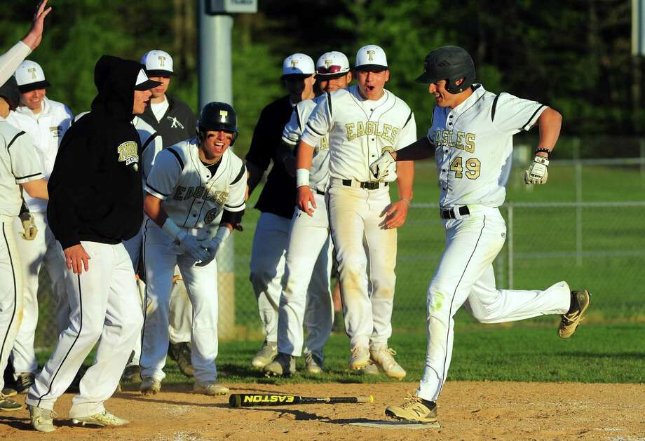As teammate cheer Trumbull's Tony Socci lands at home plate after hitting a solo home run during baseball action against St. Joseph in Trumbull, Conn. on Wednesday May 3, 2017. Photo: Christian Abraham / Hearst Connecticut Media / Connecticut Post