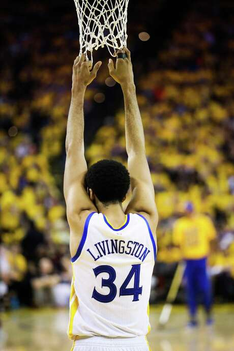 Golden State Warriors player Shaun Livingston (34) hangs on the basket during a break in the fourth quarter of Game 1 of the Western Conference Semifinals 2017 NBA playoffs between the Golden State Warriors and Utah Jazz at Oracle Arena in Oakland, California, on Tuesday, May 2, 2017. Golden State Warriors defeated the Utah Jazz 106-94. Photo: Gabrielle Lurie / The Chronicle / ONLINE_YES