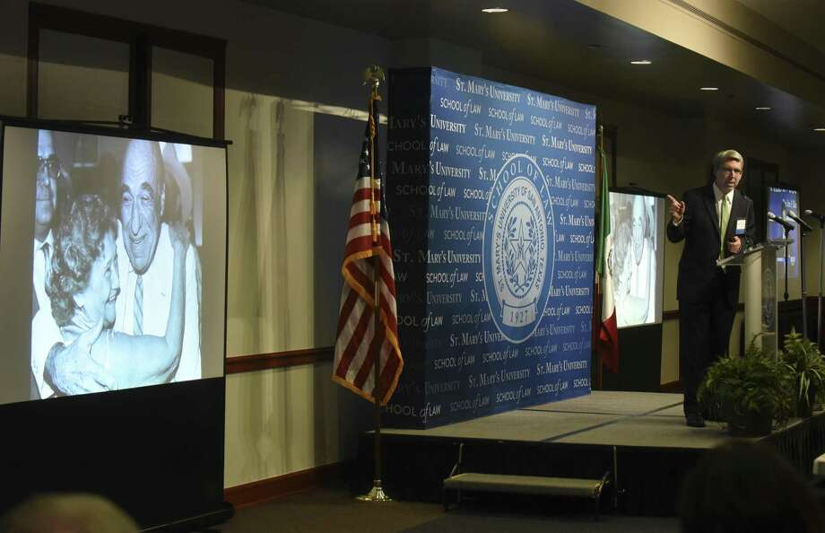 Henry B. Gonzalez III, right, speaks about his grandparents, Congressman Henry B. Gonzalez and wife Bertha, as an image of them is projected during the Gran Final of the Henry B. Gonzalez Centennial at St. Mary's University on Wednesday, May 3, 2017. The Congressman, who died in 2000, was a graduate of the St. Mary's School of Law. Photo: Billy Calzada, Staff / San Antonio Express-News / San Antonio Express-News