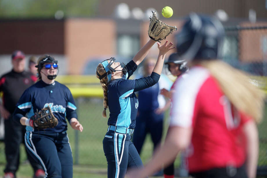 BRITTNEY LOHMILLER   blohmiller@mdn.net Meridian's Kaylee Lavack catches a pop fly in the fourth inning of the Wednesday afternoon game against Beaverton. / Midland Daily News