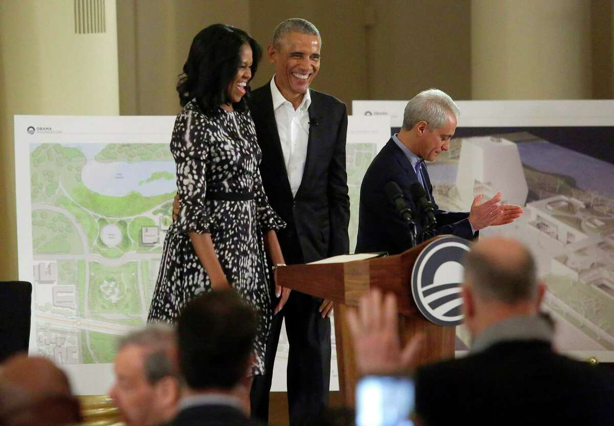 Former US President Barack Obama and First Lady Michelle Obama arrive to talk about the Obama Presidential Center during a community event at the South Shore Cultural Center on May 3, 2017 in Chicago, Illinois. At right is Chicago Mayor Rahm Emanuel. The Obama Presidential Center will be constructed in Jackson Park on Chicago's South Side Woodlawn neighborhood. / AFP PHOTO / Joshua LOTTJOSHUA LOTT/AFP/Getty Images ORG XMIT: Former US