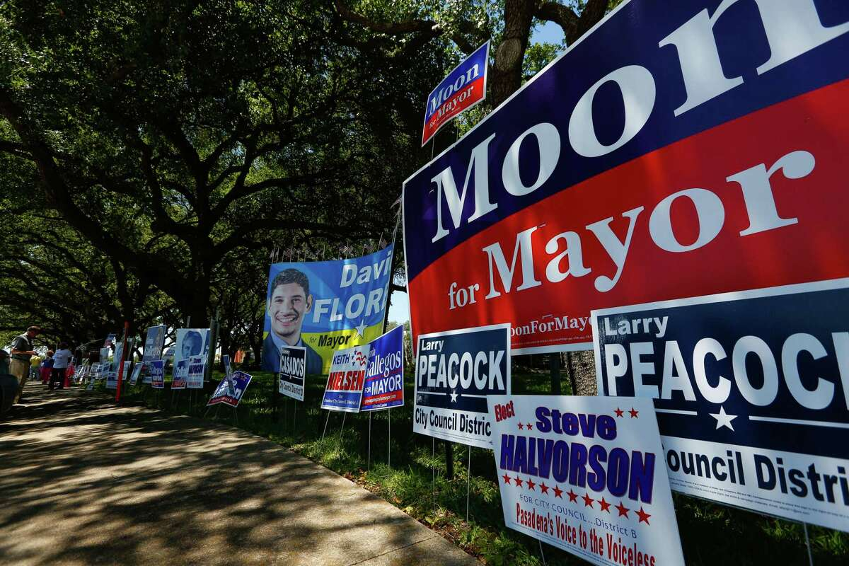 Political signs fill the sidewalk in front of the Pasadena City Hall in wait for Saturday's election.