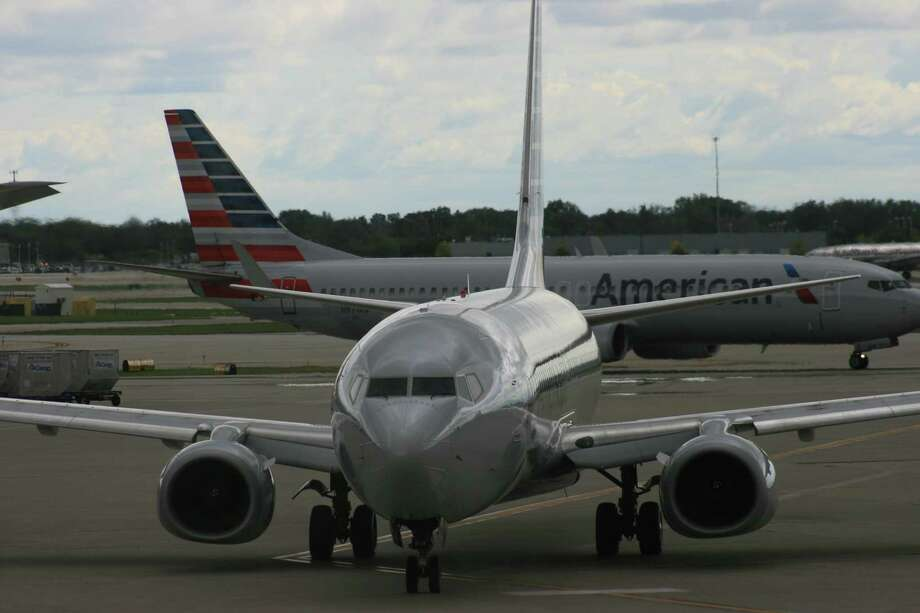 American Airlines Boeing 737 jetliners taxi at Chicago's O'Hare International Airport. On American's newest 737s, the Max model, legroom will decrease. Photo: Bill Montgomery
