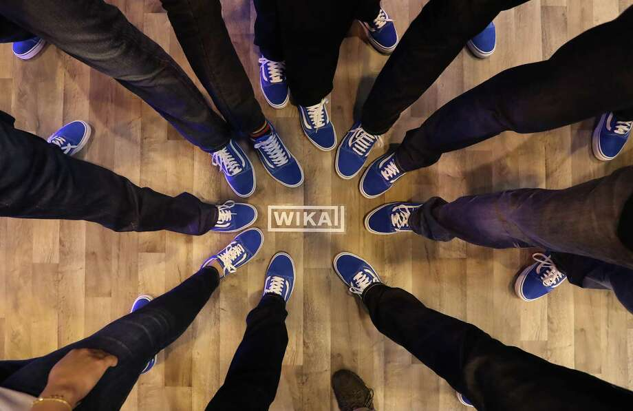 Employees of Wika Instrument sport blue Vans and blue jeans on the floor of the Offshore Technology Conference. Photo: Steve Gonzales, Staff / © 2017 Houston Chronicle