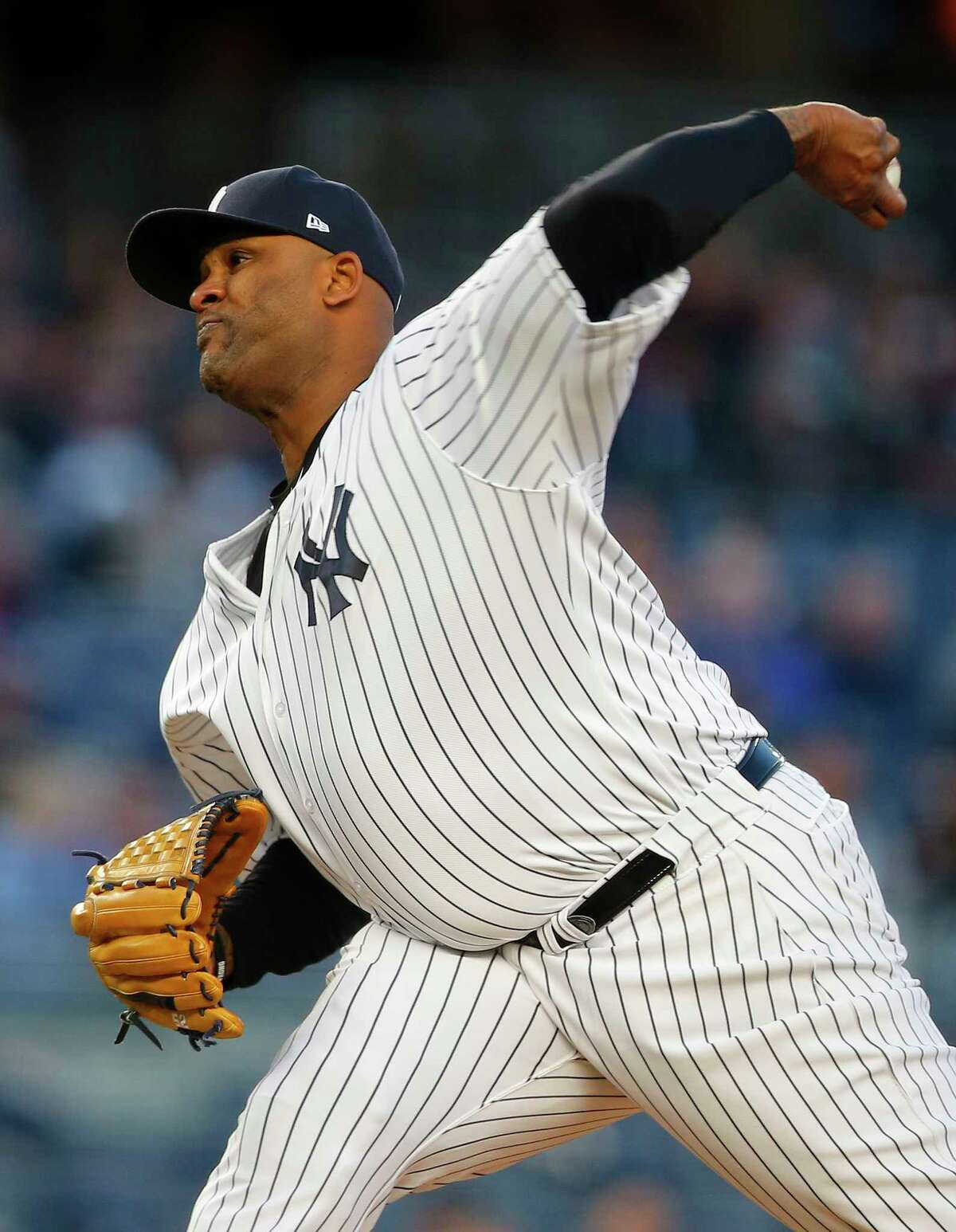NEW YORK, NY - MAY 03: Pitcher CC Sabathia #52 of the New York Yankees delivers a pitch in the first inning against the Toronto Blue Jays during a game at Yankee Stadium on May 3, 2017 in the Bronx borough of New York City. (Photo by Rich Schultz/Getty Images) ORG XMIT: 700010634