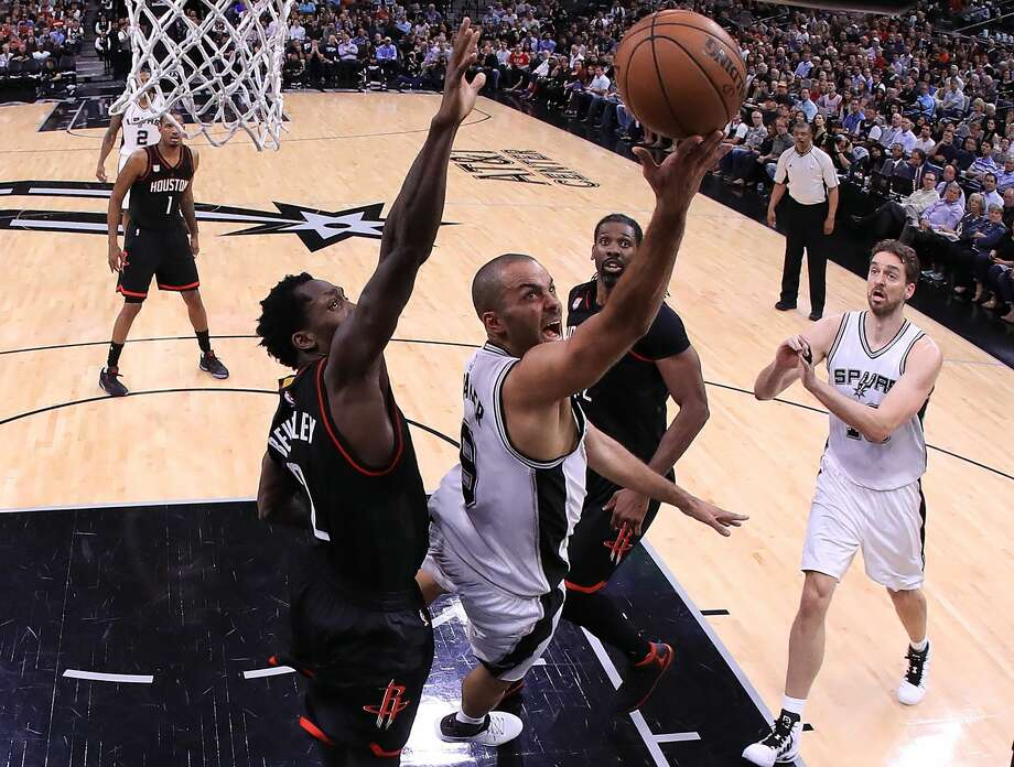 Tony Parker #9 of the San Antonio Spurs drives against Patrick Beverley #2 and Nene Hilario #42 of the Houston Rockets during Game Two of the NBA Western Conference Semi-Finals at AT&T Center on May 3, 2017 in San Antonio, Texas. Photo: Ronald Martinez/Getty Images