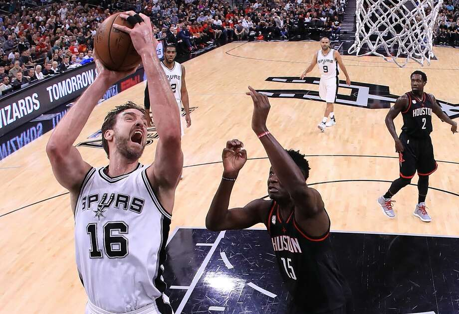 SAN ANTONIO, TX - MAY 03:  Pau Gasol #16 of the San Antonio Spurs shoots against Clint Capela #15 of the Houston Rockets during Game Two of the NBA Western Conference Semi-Finals at AT&T Center on May 3, 2017 in San Antonio, Texas.  NOTE TO USER: User expressly acknowledges and agrees that, by downloading and or using this photograph, User is consenting to the terms and conditions of the Getty Images License Agreement.  (Photo by Ronald Martinez/Getty Images) Photo: Ronald Martinez/Getty Images