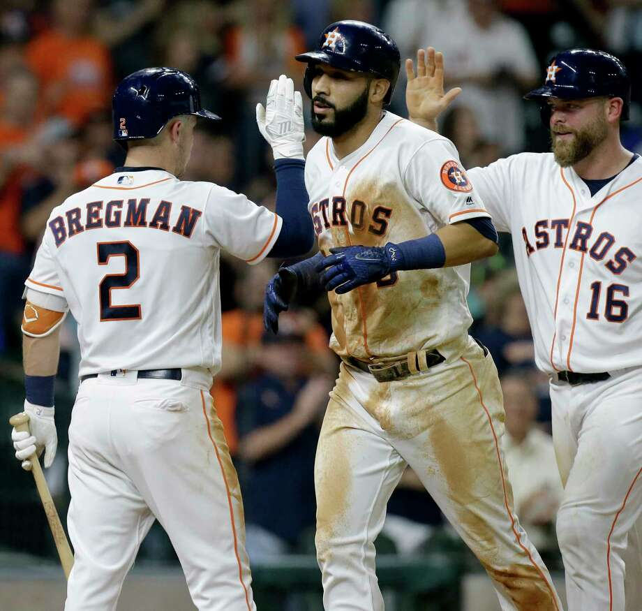 Marwin Gonzalez, center, gets pats on the front and back from Alex Bregman and Brian McCann after hitting his Astros-best eighth homer Wednesday night. Photo: Melissa Phillip, Staff / © 2017 Houston Chronicle
