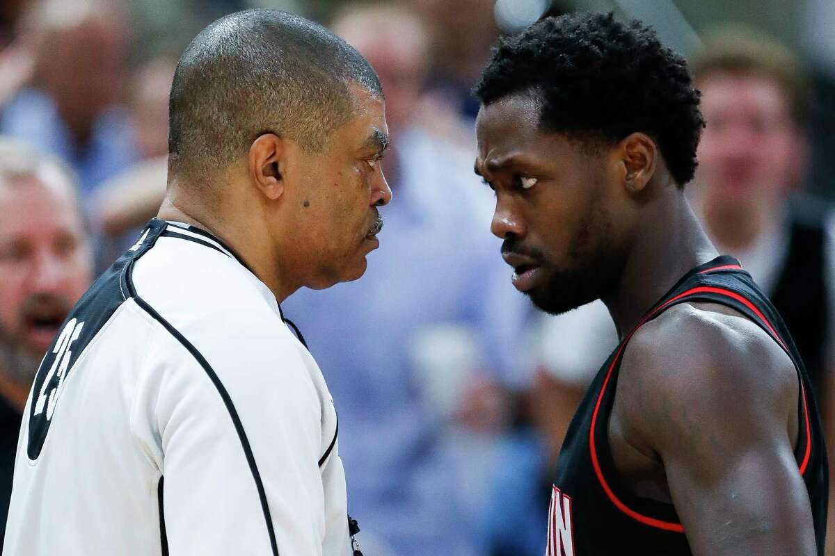 Houston Rockets guard Patrick Beverley (2) talks to referee Tony Brothers during the first half of Game 2 of the second-round of the Western Conference NBA playoffs at AT&T Center, Wednesday, May 3, 2017, in San Antonio.