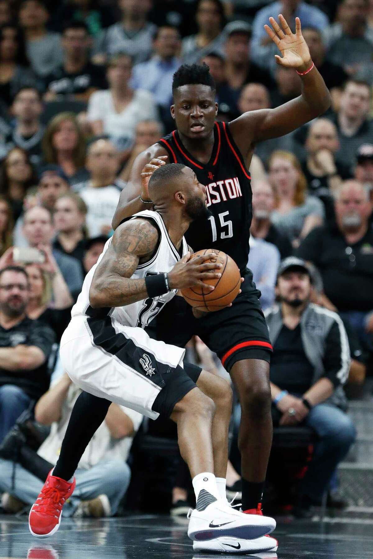 San Antonio Spurs guard Jonathon Simmons (17) looks for a shot over Houston Rockets center Clint Capela (15) during the first half of Game 2 of the second-round of the Western Conference NBA playoffs at AT&T Center, Wednesday, May 3, 2017, in San Antonio.