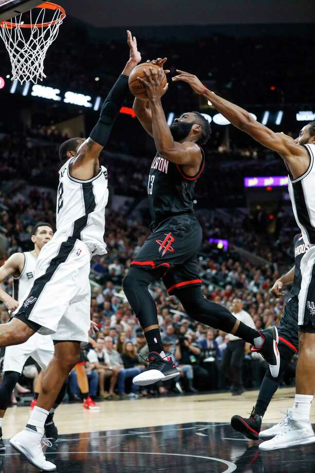 San Antonio Spurs forward LaMarcus Aldridge (12) looks to block a shot by Houston Rockets guard James Harden (13) during the first half of Game 2 of the second-round of the Western Conference NBA playoffs at AT&T Center,  Wednesday, May 3, 2017, in San Antonio. ( Karen Warren / Houston Chronicle ) Photo: Karen Warren, Staff Photographer / 2017 Houston Chronicle