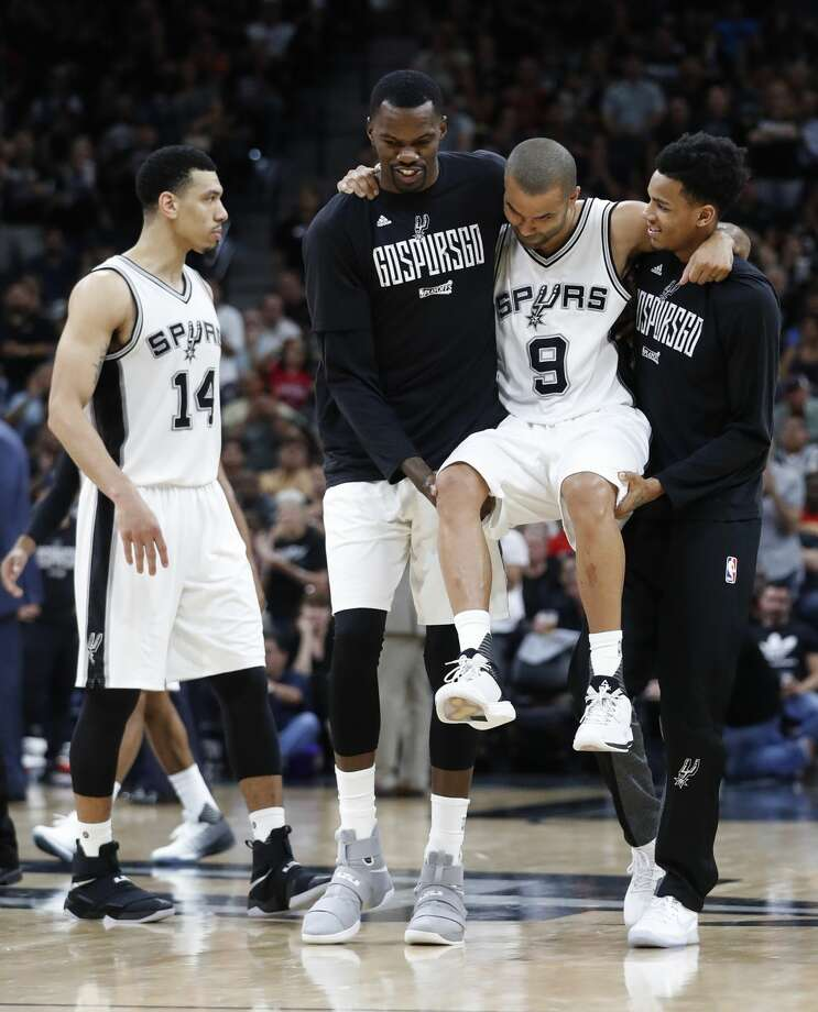 San Antonio Spurs guard Tony Parker (9) is carried off the court after being injured during the second half of Game 2 of the second-round of the Western Conference NBA playoffs at AT&T Center,  Wednesday, May 3, 2017, in San Antonio. ( Karen Warren / Houston Chronicle ) Photo: Karen Warren/Houston Chronicle