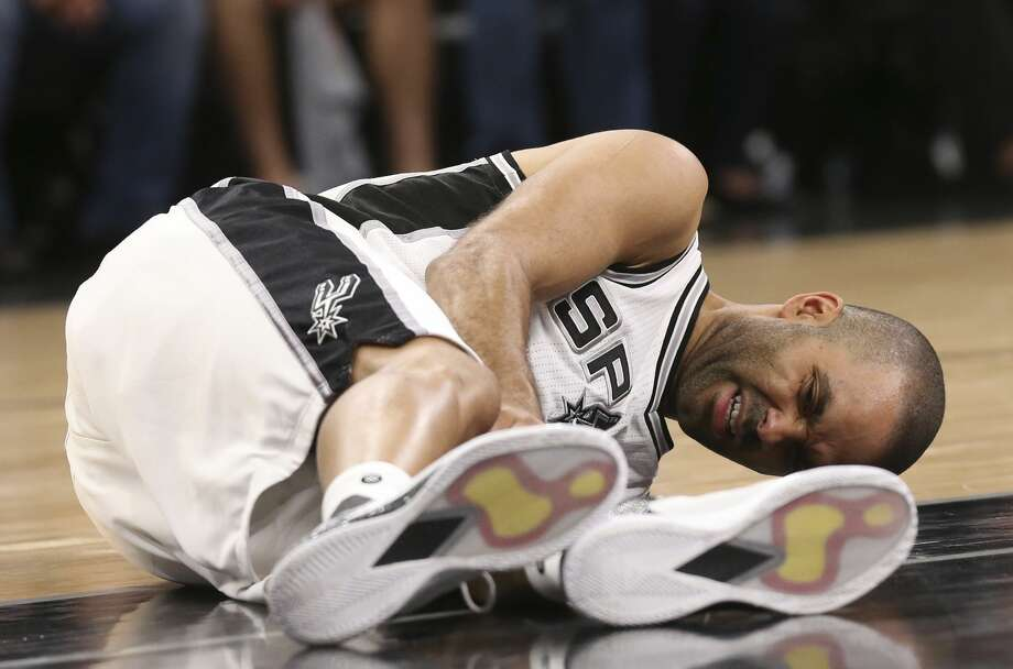 San Antonio Spurs' Tony Parker holds his left knee during the fourth quarter of game two in the Western Conference semifinals against the Houston Rockets at the AT&T Center, Wednesday, May 3, 2017. Photo: JERRY LARA/San Antonio Express-News