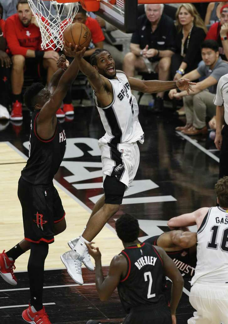 Spurs' Kawhi Leonard (02) scores on a foul against Houston Rockets' Clint Capela (15) in Game 2 of the Western Conference semifinals at the AT&T Center on Wednesday, May 3, 2017. (Kin Man Hui/San Antonio Express-News)