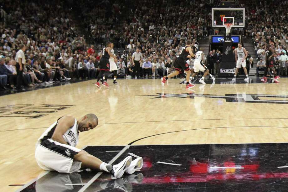 Spurs' Tony Parker lies on the floor after getting injured in the fourth quarter of Game 2 against the Houston Rockets at the AT&T Center on May 3, 2017. Photo: Jerry Lara /San Antonio Express-News / © 2017 San Antonio Express-News