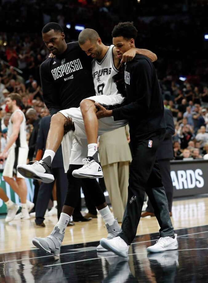 Spurs point guard Tony Parker had to be carried off the court in the fourth quarter Wednesday when he landed awkwardly and appeared to injure his left knee during San Antonio's 121-96 win over the Rockets. Photo: Karen Warren, Staff Photographer / 2017 Houston Chronicle