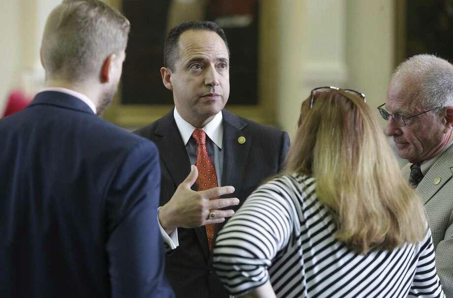 Senator Jose Menendez chats with his staff as he introduces bullying legislation on the floor of the Texas Senate on Wednesday, May 3, 2017. Photo: Tom Reel, Staff / San Antonio Express-News / 2017 SAN ANTONIO EXPRESS-NEWS