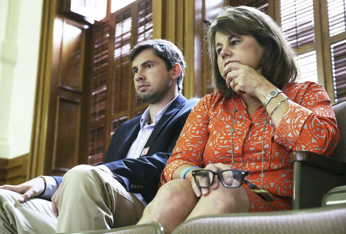 Maurine Molak watches from the gallery with her son Cliff Molak as Senator Jose Menendez introduces bullying legislation on the floor of the Texas Senate on Wednesday, May 3, 2017. Molak's son David committed suicide under stress of cyber bullying.