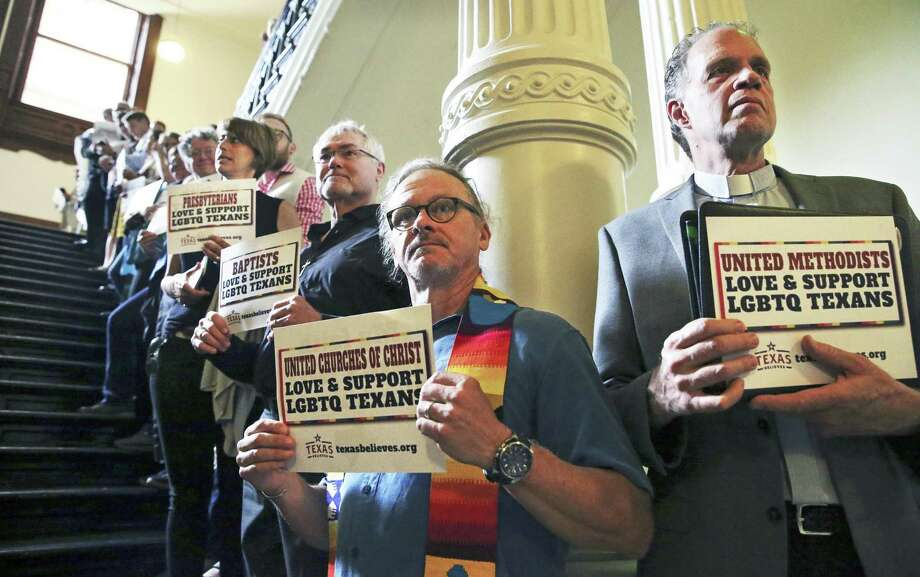 Pastor Tom Vandestadt (center) of Austin Congregational Church and Griff Martin (right), pastor at First Baptist Church of Austin stand on the stairway as faith leaders gather outside the chamber of the House of Representatives in the State Capitol on Wednesday morning, May 3, 2017,  to demonstrate support for the LGBT community with prayer and song.  Behind Vandestadt is University Baptist pastor Larry Bethune. Photo: Tom Reel, Staff / San Antonio Express-News / 2017 SAN ANTONIO EXPRESS-NEWS