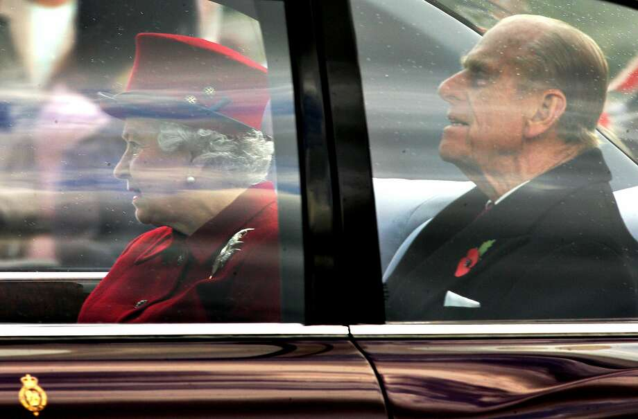 Britain's Queen Elizabeth II (left) and Prince Phillip leave Buckingham Palace in London 08 November 2005. Prince Philip will retire  from royal duties this fall, Buckingham Palace said Thursday. Photo: CARL DE SOUZA, AFP/Getty Images