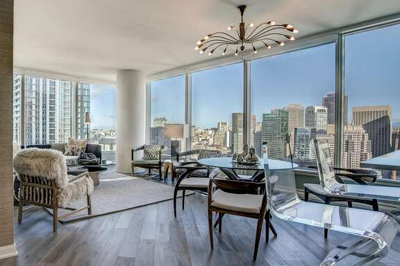 The 32nd floor unit offers floor-to-ceiling windows and an open floor plan.