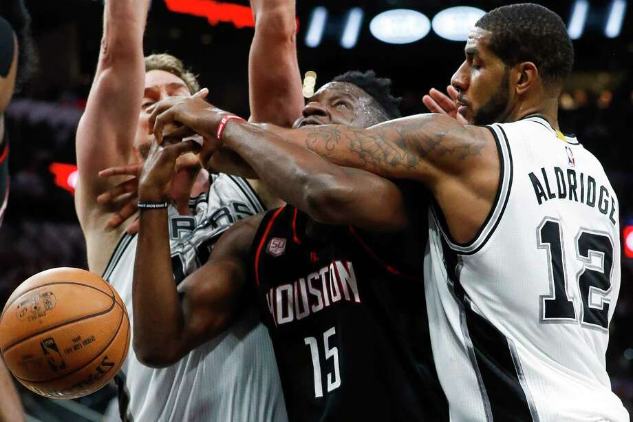 Houston Rockets center Clint Capela (15) is pressured by San Antonio Spurs center Pau Gasol (16) and forward LaMarcus Aldridge (12) during the second half of Game 2 of the second-round of the Western Conference NBA playoffs at AT&T Center,  Wednesday, May 3, 2017, in San Antonio. ( Karen Warren / Houston Chronicle ) Photo: Karen Warren, Staff Photographer / 2017 Houston Chronicle