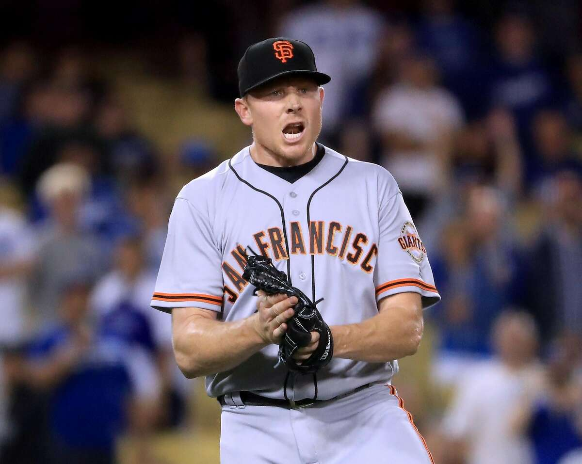 LOS ANGELES, CA - MAY 03: Mark Melancon #41 of the San Francisco Giants celebrates the final Los Angeles Dodgers out for a 4-1 win during the 11th inning at Dodger Stadium on May 3, 2017 in Los Angeles, California. (Photo by Harry How/Getty Images)