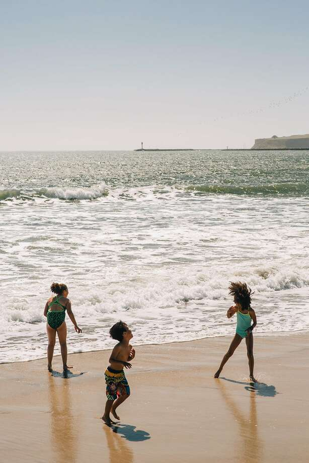 Children play in the ocean on an unseasonably hot day at the beach in Half Moon Bay on April 29th, 2017. Photo: Peter Prato, Special To The Chronicle