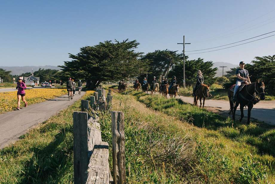 People run, bike, and ride horseback on the Half Moon Bay Coastal Trail next to Francis Beach in Half Moon Bay, California, on April 30th, 2017. Photo: Peter Prato, Special To The Chronicle