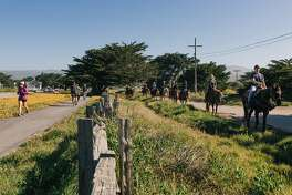 People run, bike, and ride horseback on the Half Moon Bay Coastal Trail next to Francis Beach in Half Moon Bay, California, on April 30th, 2017.