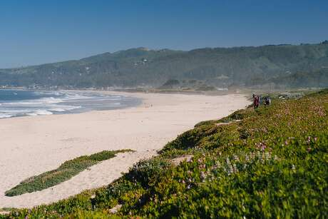 Hikers walk out toward Half Moon Bay State Beach on May 1st, 2017.