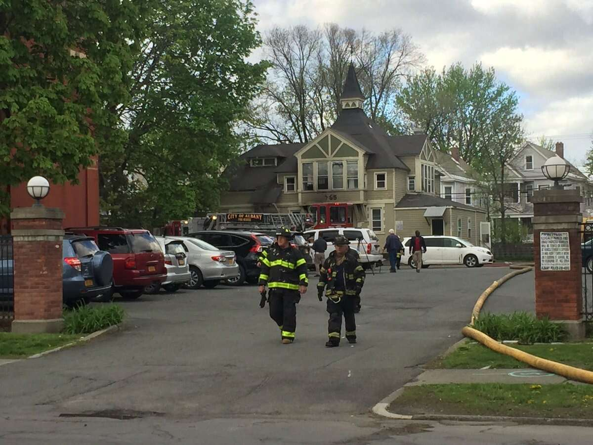 A woman was taken to the hospital after fire Wednesday damaged a home on Madison Avenue.
