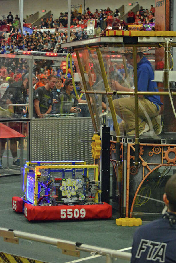 The robot from Midland High's Team 5509 delivering a gear during competition.