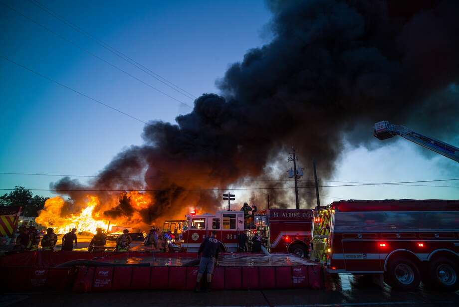 Local firefighters overlook a blaze that engulfed Charlie's Bar-B-Q restaurant in the 8200 block of Airline Drive in Houston, Texas on May 4, 2017. Photo: Godofredo A. Vasquez/Houston Chronicle