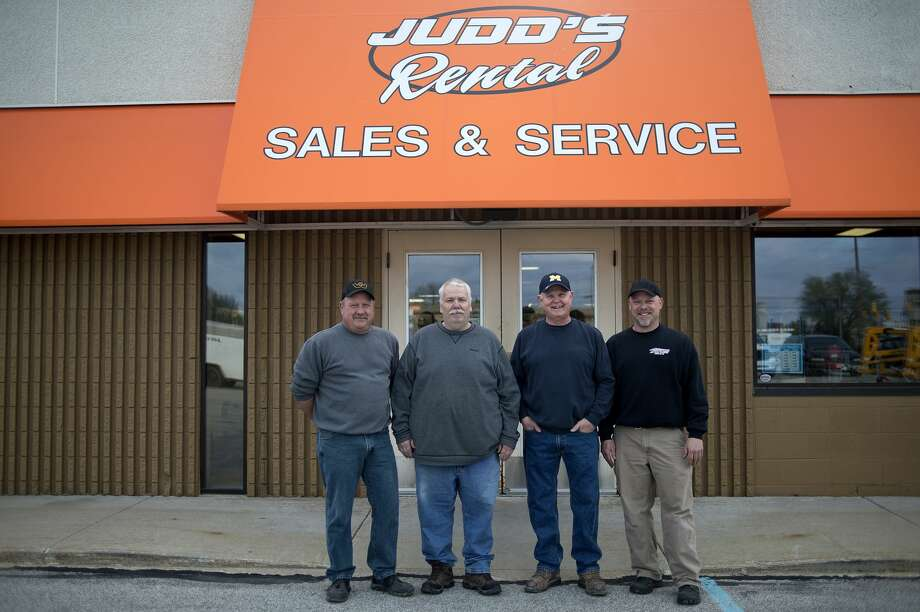 Judd's Rental employees from left: John Ross, Steve Laney, Jim Keppel and Dan Ware pose for a portrait outside Judd's Friday morning. Judd Rental will be celebrating it's 50th anniversary May 6. Photo: Brittney Lohmiller/Midland Daily News/Brittney Lohmiller