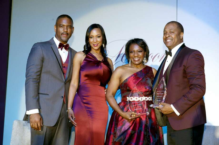 Texas Southern University Dr. Austin Lane and his wife, Loren Lane, with alumni honorees Alaina Benford, an attorney, and Tony Wyllie, vice president of communications for the Washington Redskins.  Photo: Texas Southern University