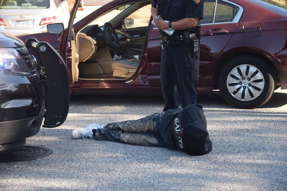 Police arrested a man Thursday morning in a Northwest Side subdivision after he pulled off a string of donuts in his car at an intersection and then began driving into oncoming traffic. Photo: Caleb Downs / San Antonio Express-News