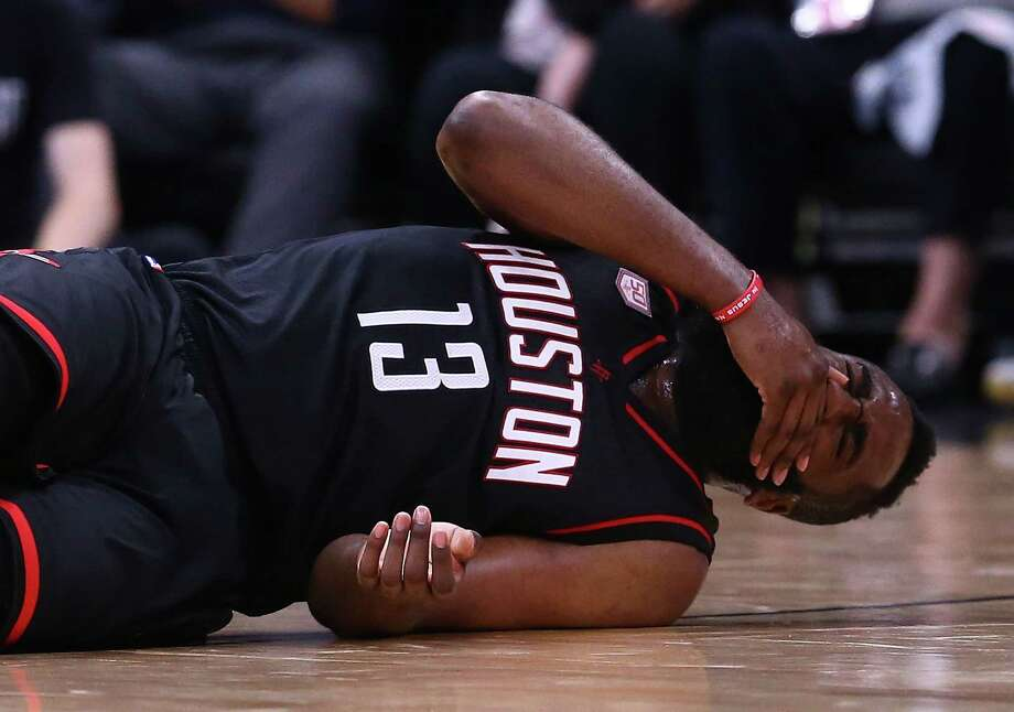 SAN ANTONIO, TX - MAY 03:  James Harden #13 of the Houston Rockets reacts on the floor against the San Antonio Spurs during Game Two of the NBA Western Conference Semi-Finals at AT&T Center on May 3, 2017 in San Antonio, Texas.  NOTE TO USER: User expressly acknowledges and agrees that, by downloading and or using this photograph, User is consenting to the terms and conditions of the Getty Images License Agreement. Photo: Ronald Martinez, Getty Images / 2017 Getty Images