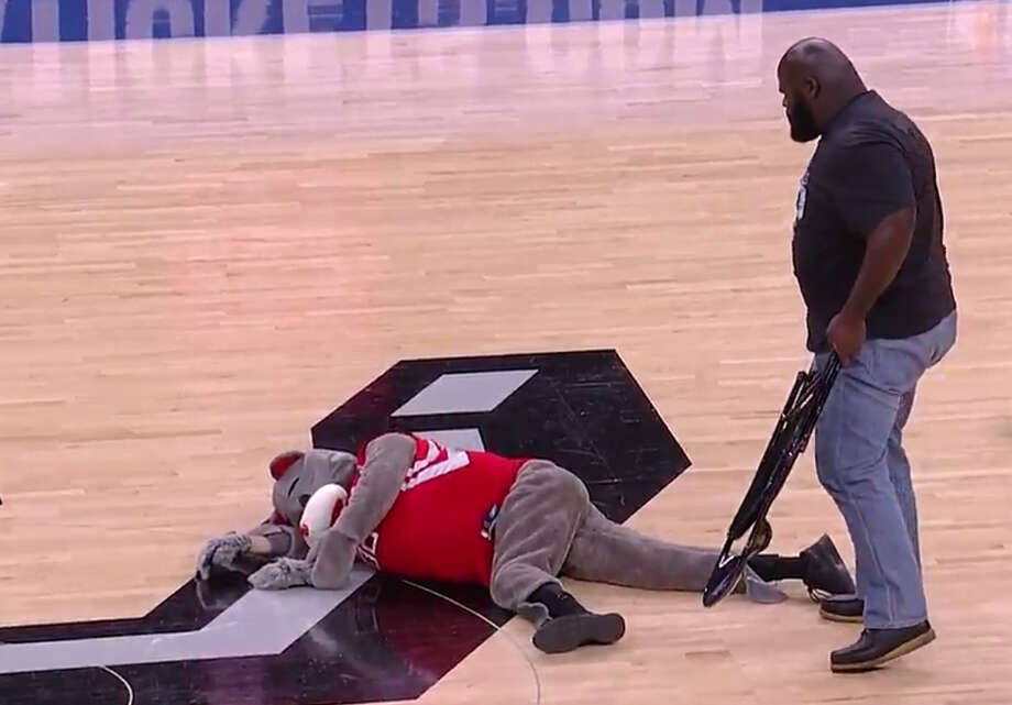 Former WWE star Mark Henry took to the court and blasted a fake Houston Rockets mascot with a steel chair during Game 2 of the Rockets-Spurs playoff series in San Antonio on Wednesday night. Photo: Brian T. Smith