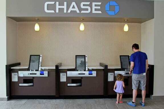 The number of bank branches continues to fall as more consumers opt to handle their financial matters online or through smartphone apps. (For the Chronicle/Gary Fountain, May 22, 2015)