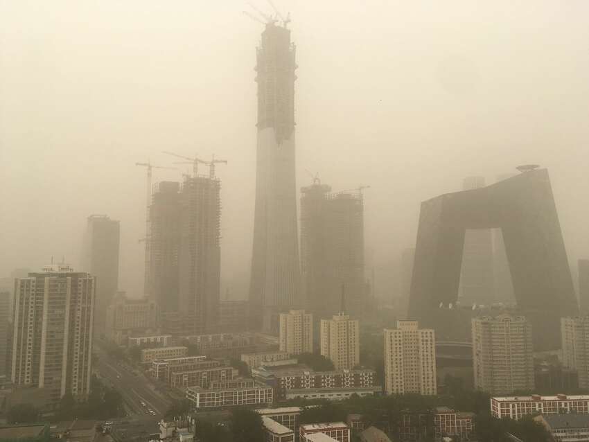 BEIJING, 0 - MAY 04: BEIJING, 0 - MAY 04: BEIJING, 0 - MAY 04: Buildings in CBD seen in a sandstorm on May 4, 2017 in Beijing, China. Beijing issues a blue warning for sandstorm at 5:30 Thursday. (Photo by VCG/VCG via Getty Images)